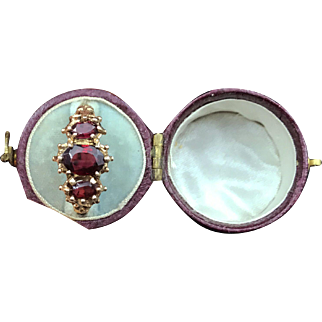 Superb Victorian Garnet Trilogy Ring with Ornate Gallery And Figural Shoulders
