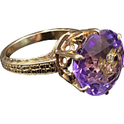 Wonderful Victorian Amethyst Ring in 14K solid gold with engraved flower and three inset diamonds. Size 4.5 and weighing 5.3 grams.