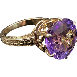 Wonderful Victorian Amethyst Ring in 14K solid gold with engraved flower and three inset diamonds. Size 4.5 and weighing 53 grams.