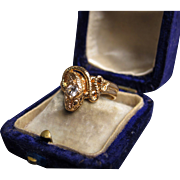 """Salazar's Treasure"" 18k Gold Snake Ring with single round-cut Diamond circa 1920 (size 7)"