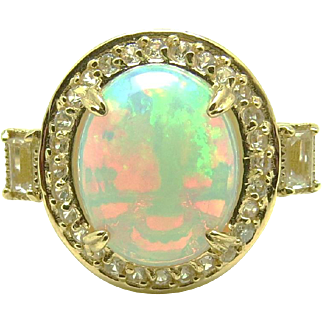Ethiopian Fire Opal, Pink Sapphire and Topaz 14 Karat Gold Halo Ring