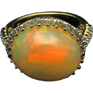 Ethiopian Welo Fire Opal and Diamond halo 14 karat Gold ring