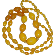 "Egg yolk Bakelite Necklace 36"" single strand graduated Bakelite 66.4 grams"