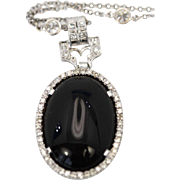 Art Deco Onyx Platinum Pendant with a Diamond surround