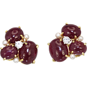Seaman Schepps Ruby Cabochon earrings with 3 cultured saltwater seed pearls and 1 diamond pierced