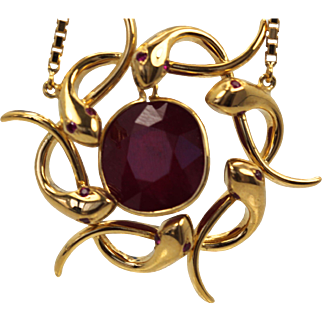 Retro Snake Wreath Necklace with 6 snakes encircling a 9.00 Carat center Ruby in 18K Yellow Gold with a 22K Yellow Gold Chain