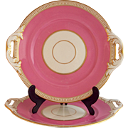 A pair of pierced Minton Plates, 19th century, pink and gilt decoration