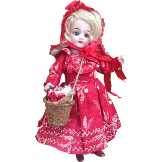 """Adorable and Rare A/O 7"""" All Bisque ' Le Petit Chaperon Rouge' Mignonette ( 'Little Red Riding Hood' ) in her Original Trunk with integral 'Grandmother's bed. Charming!"""