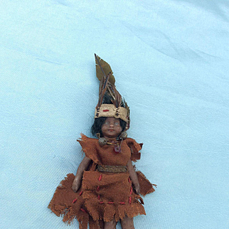 Bare foot, All Bisque, Mulatto Mignonette in lovely original 'Tiger Lily' costume.