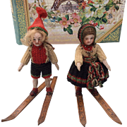 Charming pair of All Bisque mignonettes in Excellent, all original condition, complete with skis!