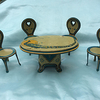 Antique Tin plate Dolls House Table and four Chairs. Mignonette furniture.