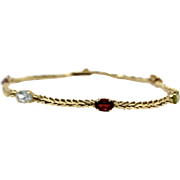 Multi stone bracelet 14k Yellow Gold Gemstones Peridot Amethyst Aquamarine Garnet Citrine