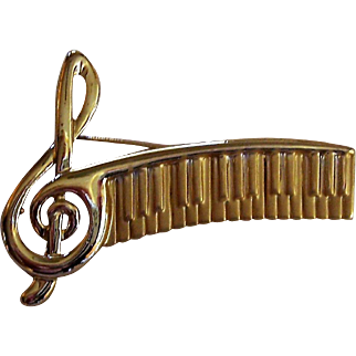 Brooch with keyboard and musical clef theme