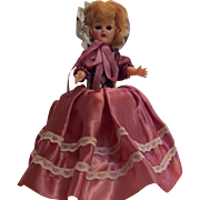 Hard plastic storybook doll