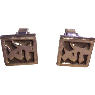 Cufflinks with Chinese letters.