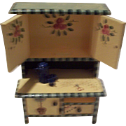 Minature doll house cupboard with painted decoration and granite coffee pot and cups