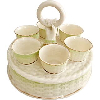 Belleek egg holder, green shaded Basket Weave with hand, 3rd Green Mark