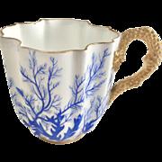 Antique Coalport demitasse coffee cup, quatrefoil with gilded reptile handle, 1880s