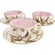 Three Ott & Brewer Belleek eggshell teacups with flowers and insects, 1880s