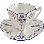 Shelley Art Deco demitasse cup and saucer, Blue Iris pattern on Queen Anne shape, 1927