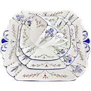 Shelley Art Deco teacup quartet, Blue Iris pattern on Queen Anne shape, 1927