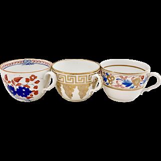 Set of three orphaned Spode teacups, bute shape, 1805-1810