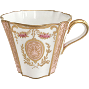 Wedgwood coffee cup, peach with gilt pattern, 1879