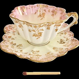 "Antique Charles Wileman ""Empire"" demitasse cup, gilt ivy on pink blush, 1893"