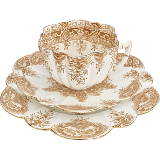 Charles Wileman teacup trio, brown Paradise pattern 6239 on Daisy shape, 1890