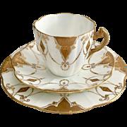 Rare Charles Wileman teacup trio, gilt Ornament Festooned patt. 3932 on Lily shape, 1889