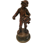 Antique Bronze Of A Young Boy Selling Kitchen Wares