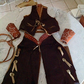 1940s Child's cowboy chaps and vest, cowhide with vintage leather adjustable cuffs and free whip is desired