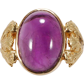 Amethyst cabochon ring in 18 karat yellow gold  and sterling silver.