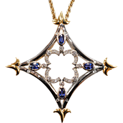 Natural sapphire and diamond pendant in 18 karat gold and continuum  silver.