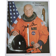 Astronaut and Senator John H. Glenn, Jr. signed photograph in astronaut suit.