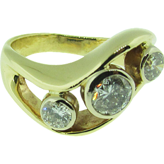 14 K gold and diamond wave design ring.