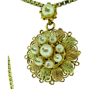 10 K rose and yellow gold pearl brooch / pendant. Circa 1950.
