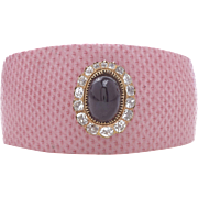 Pink Lizard Cuff with a Cabochon Garnet that is Surrounded by 16 Old Mine Diamonds
