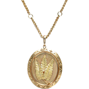Antique 18 KT. Yellow Gold Locket with Leaf Motif on a Chain