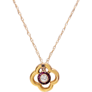 14 KT. Yellow Gold Quatrefoil Diamond and Ruby Pendant
