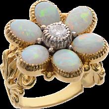 Flowerhead Opal & Diamond Ring set in 18 KT. Gold