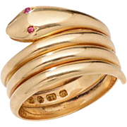 Triple Coiled Polished 18 KT. Yellow Gold Serpent Ring with Ruby Eyes
