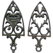 2 Cast Iron Trivets with Curlicue Design; one with Heart marked Shapleigh & Co.