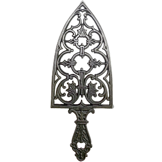 Ornate German Cast Iron Trivet with Traces of Original Japanned Finish