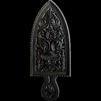 Intricate German Cast Iron Trivet with Decorative Handle