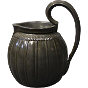 Small jug with handle in disco metal by Just Andersen.
