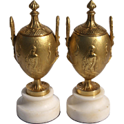 Pair Of 19th Century Gilt Bronze Lidded Urns On Marble Base