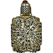 French Miniature Perfume Bottle with Silver Filigree Casing.