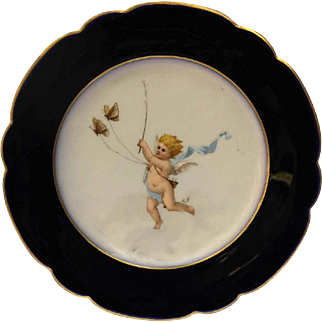 French Antique Porcelain Cabinet Plate with Hand Painted Cherub Chasing Butterflies.