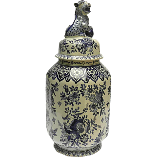 Dutch Delft Blue and White Baluster Vase and Cover with Foo Dog Figurine Finial.